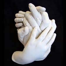 hand statue together